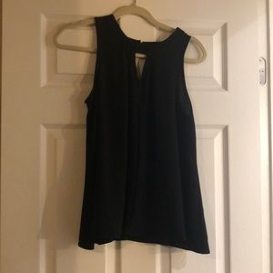 Black sleeveless dressy tank, peep whole front